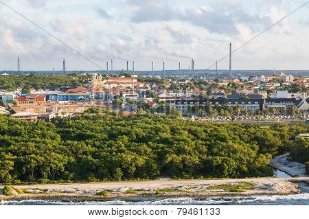 Colorful Buildings And Heavy Industry In Curacao