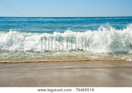 Beach and big wave in Laguna Beach, California