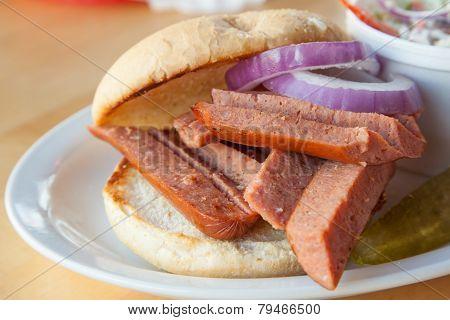 Sausage burger with cold slow salad