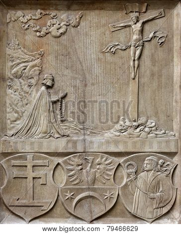 VIENNA, AUSTRIA - OCTOBER 10: An old crucifixion relief sculpture outside St. Stephen's Cathedral in Vienna, Austria on October 10, 2014
