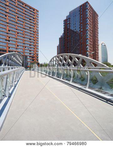 footbridge and office building in modern city