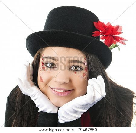 Close-up of a beautiful teen girl in black top hat and white gloves happily resting her heart-decorated face in her hands.  On a white background.
