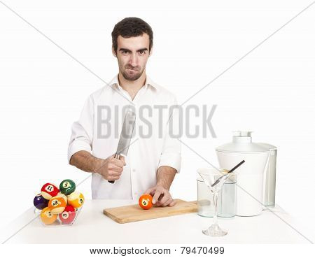 Young  Man Chef Cooking Orange Juice. Fresh Ingredients On Table. Studio Shot. White Background. Bil