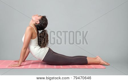 Young Woman Performing Yoga Asana