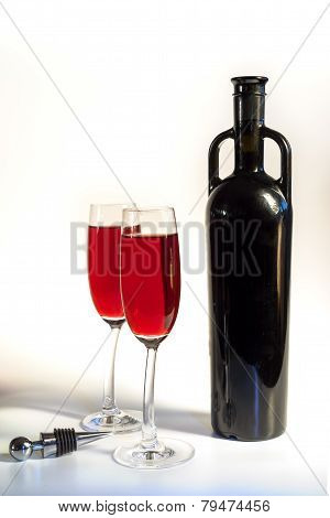 Original Red Vine Bottle And Two Wine Glasses On The White Background