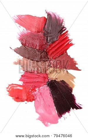 Lipstick strokes isolated on white background