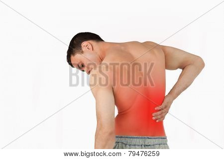 Back view of man suffering from back pain against a white background