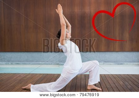 Content brunette in white doing tai chi against heart