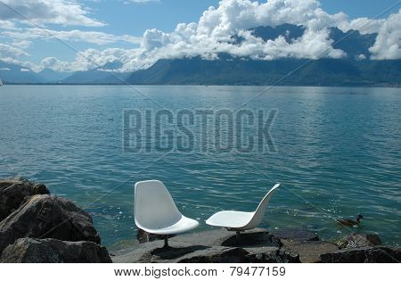 Two White Chairs At Geneve Lake