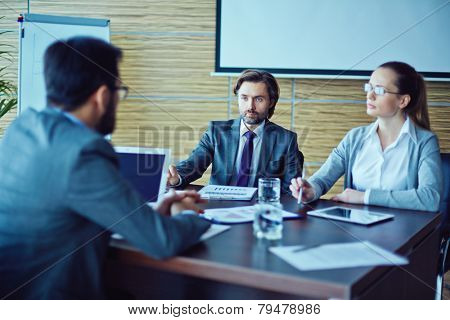 Two employers talking to a new worker