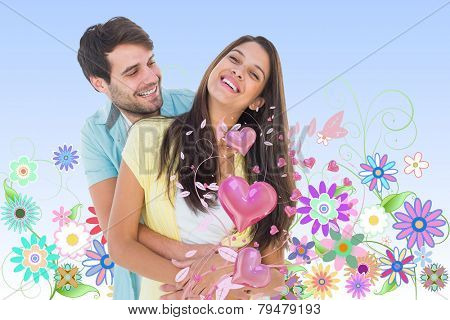 Happy casual couple smiling and hugging against digitally generated girly floral design