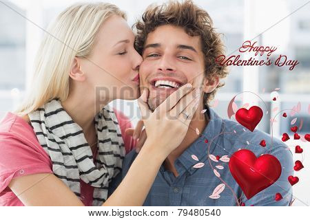 Woman kissing man on his cheek against cute valentines message