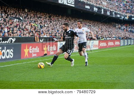 VALENCIA, SPAIN - JANUARY 4: Carvajal with ball and Piatti during Spanish League match between Valencia CF and Real Madrid at Mestalla Stadium on January 4, 2015 in Valencia, Spain