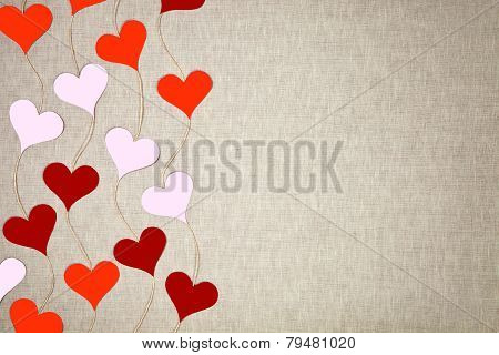 Hearts garlands on linen background
