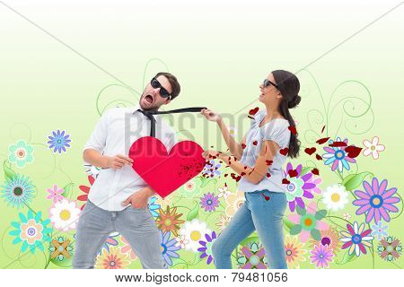 Brunette pulling her boyfriend by the tie against digitally generated girly floral design