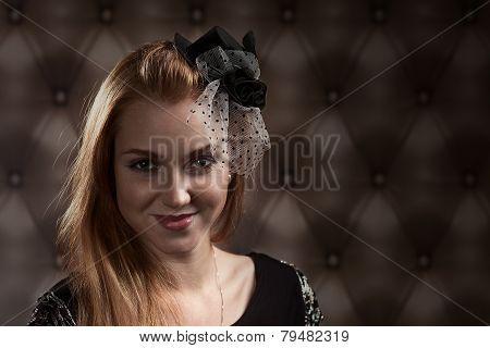 Redhaired Woman In Black Hat