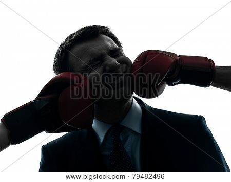 one  businessman punch by boxing gloves in silhouette studio isolated on white background