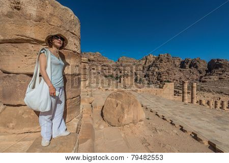 tourist standing roman temple in Nabatean Petra Jordan middle east