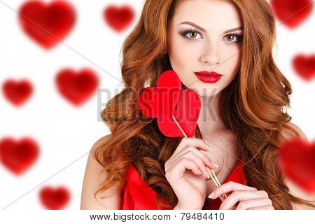 Beautiful girl in a Valentine's Day with a heart on a stick.