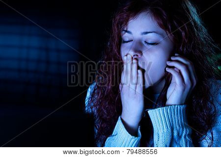 Yawning Woman Working with a Computer