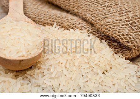 Rice From The Bag And Wooden Spoon