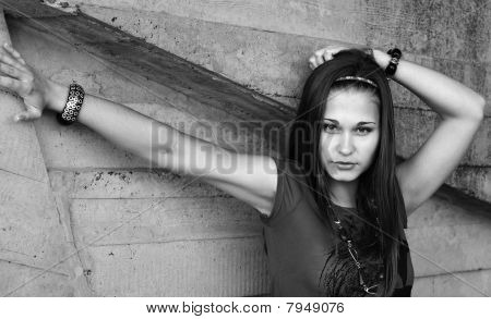 Greyscale Portrait Of The Girl By The Concrete Wall