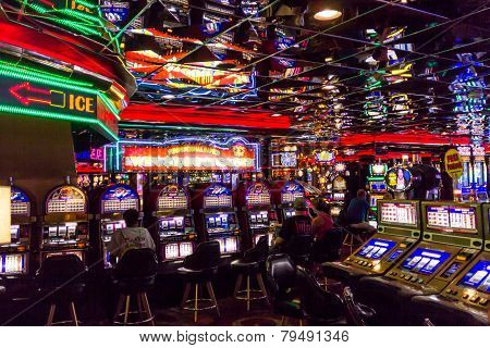 Slot Machine Players In Casino Royale Hotel