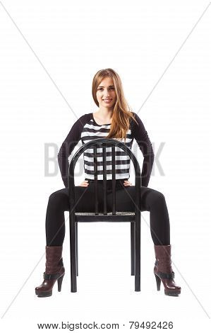 Woman Sitting On A Chair And Holding Hands On Hips