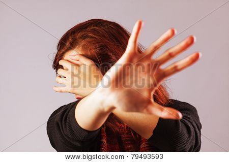 Woman Protecting Herself