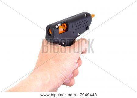 Kleben Sie Pistole in der Hand isolated on white Background.