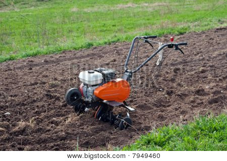 Cultivator On A Field.