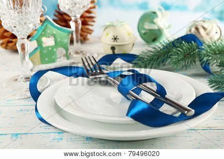Holiday table setting with Christmas decoration and light background