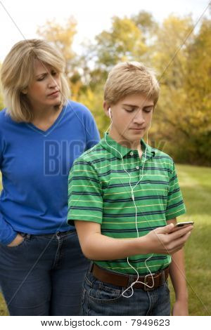 Son Ignoring Mother Listening to Music Player