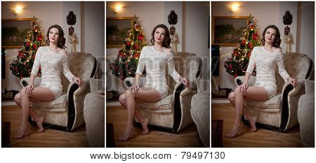 Beautiful sexy woman with Xmas tree in background sitting on elegant chair in cozy scenery