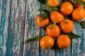 foto of clementine-orange  - Natural sweet clementines on rustic table from above - JPG