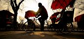 stock photo of rickshaw  - Man riding a Rickshaw - JPG