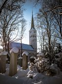 foto of graveyard  - A Snowy Church And Graveyard In The Winter - JPG