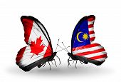 stock photo of malaysia  - Two butterflies with flags on wings as symbol of relations Canada and Malaysia - JPG