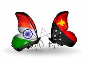 stock photo of papua new guinea  - Two butterflies with flags on wings as symbol of relations India and Papua New Guinea - JPG