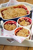 stock photo of apricot  - Strawberry and apricot crumble on a tray  - JPG