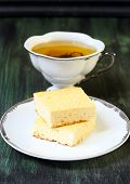 picture of cheesecake  - Squares of cheesecakes and cup of green tea - JPG