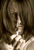 image of drug addict  - Young woman with drug addiction on dark background - JPG