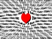 image of hate  - Words of hate surrounded by large red heart symbolizing that love is more powerful than hate - JPG