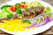 image of hake  - fish hake baked with vegetables on a plate