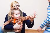 picture of goodbye  - Young woman and child boy waving goodbye - JPG