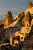 picture of chimney rock  - Hotel rooms cut down in the rock in the light of the setting sun - JPG