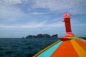 foto of phi phi  - Detail of long tail boat and beautiful Phi Phi Islands in Thailand - JPG