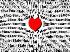 foto of hate  - Words of hate surrounded by large red heart symbolizing that love is more powerful than hate - JPG