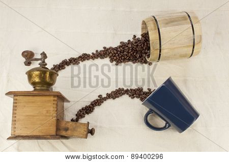 spilled coffee beans, coffee mug, old coffee grinder