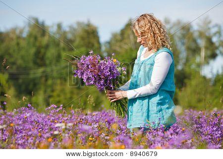 Women Picking Lilac Flowers
